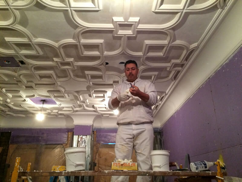 Master craftsman Hamza Alabidi, doing finishing touches during construction.