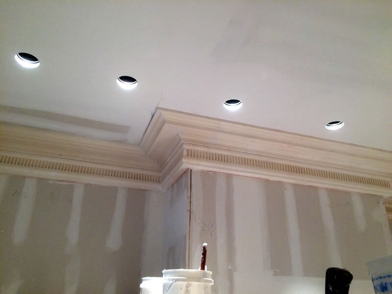 Ornamental plaster cornices added to dining room walls and ceiling, before being painted.