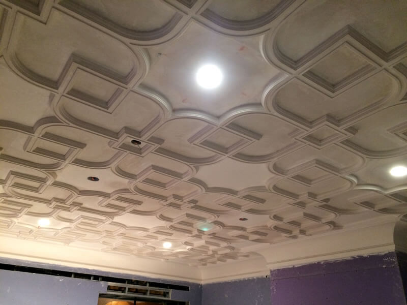 Architectural plaster and plaster cornices near completion, before being painted.