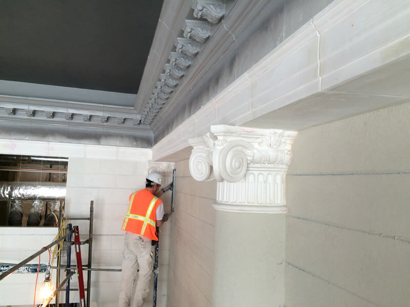 During construction, adding cornices, columns, and caps.