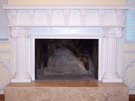 Fireplace mantle with corbels, columns, caps, and other decorative work