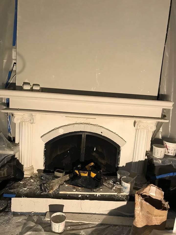 Transforming a ho-hum fireplace into a beautiful focal point with elegant columns, corbels, and a beautiful mantle.