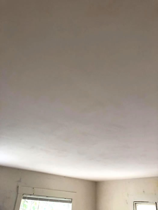 Plaster ceiling and walls after repairs.