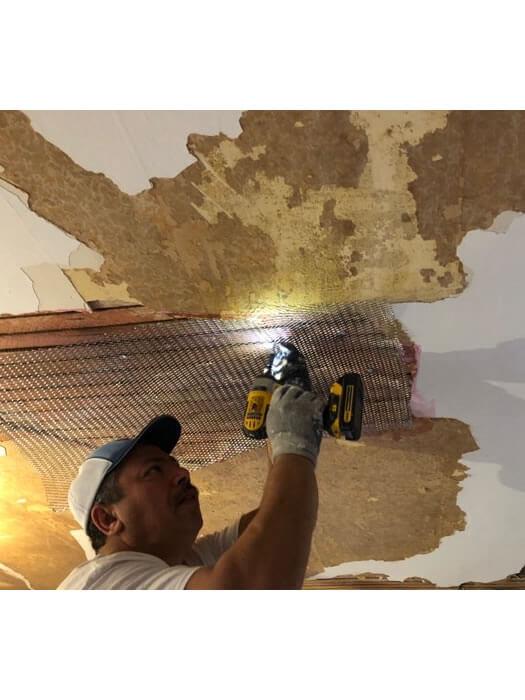 Repairing ceiling lath.