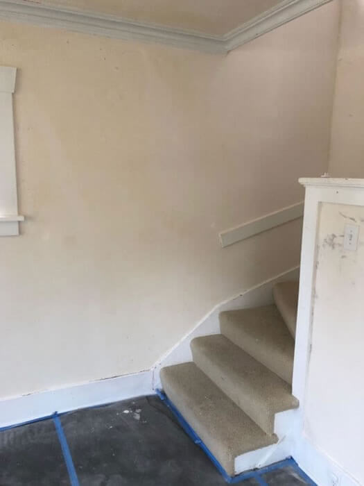 Walls at base of staircase after plaster repairs.