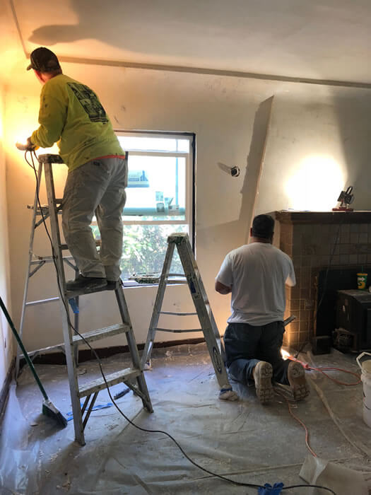 Repairing lath and plaster around fireplace and on walls and ceiling.